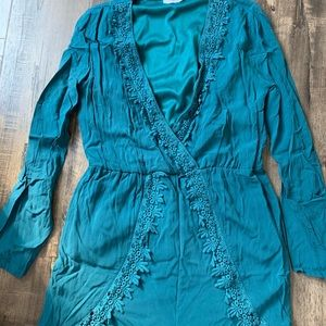 Blue green romper with fringe details